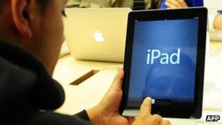 A consumer using iPad