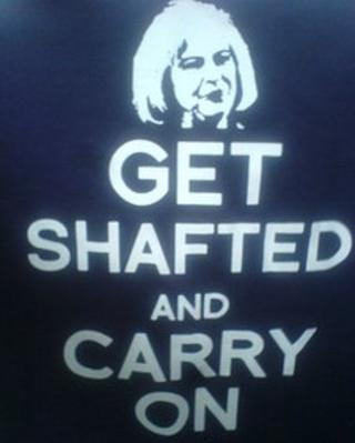 """Get shafted and carry on"" T-shirt being worn by protesting police officers"