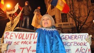 Protest in Bucharest - sign reads 'Facebook generation is here'