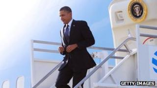 Barack Obama steps down off of Air Force One