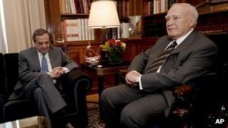Greek President Karolos Papoulias, right, with Antonis Samaras