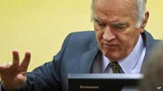 Former Bosnian Serb General Ratko Mladic at his trial at the UN Yugoslav war crimes tribunal in The Hague on 16 May 2012