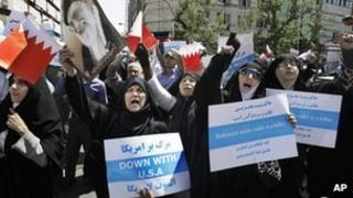 Iranian women chant slogans during a demonstration in Tehran to denounce efforts by Bahrain's Sunni rulers to forge closer ties with Saudi Arabia