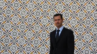 Syria's President Assad stands alone at Al-Shaab Palace in Damascus during a visit by the Greek President in 2009.