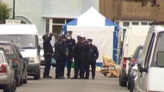 Police officers where the 25-year-old victim was found