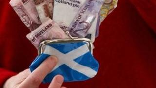 Scottish flag on purse with sterling notes