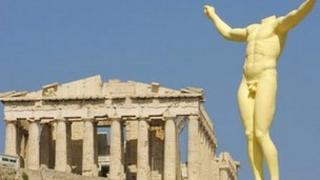 Statue and ruin in Greece