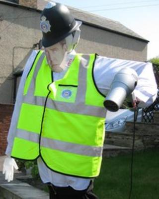 Scarecrow policeman with picture of Jeremy Clarkson's face