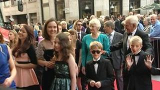 Residents of Kingston Bagpuize arriving on the red carpet in Leicester Square