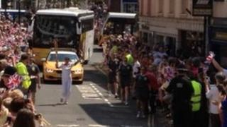 Crowds watch the relay in Carmarthen