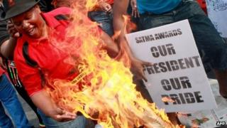 Copies of South Africa's City Press paper on fire