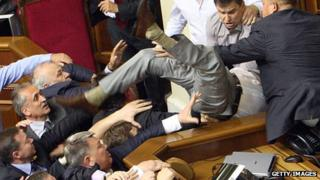 Ukrainian opposition MPs fight with the pro-presidential members in parliament