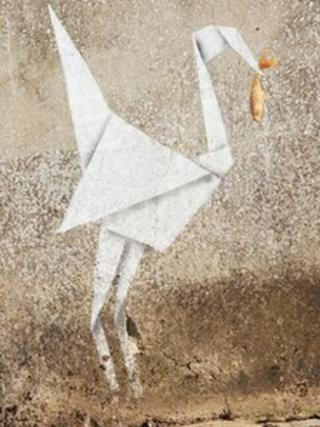 Andrew Blackmore's picture of Banksy's origami heron catching goldfish