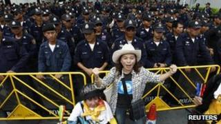 "Police standing guard as Thailand's ""yellow shirts"" protest"