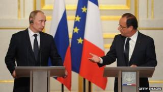 Russian President Vladimir Putin (L) and French President Francois Hollande speak during a news conference at Elysee Palace on June 1, 2012 in Paris, France