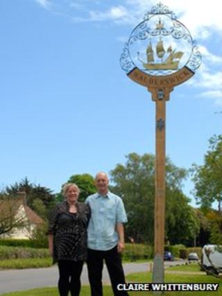 Lea and Philip Newstead next to the restored Walberswick sign