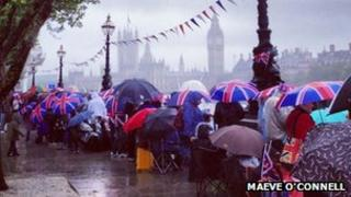 Royalists gahter in the rain by the Thames ahead of Jubilee Pageant