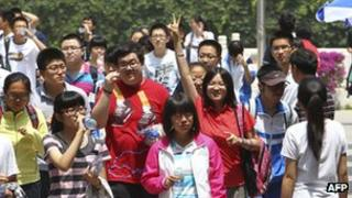 Students leaving an exam centre after finishing the first day of the college entrance exams known as Gaokao, 07 June 2012