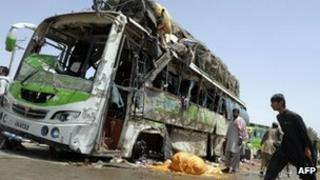 Wreckage of a bus destroyed by the bomb
