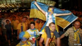 Ukraine fans celebrate outside the stadium
