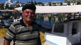 Yiannis, 79. stands at the port in Chalkida