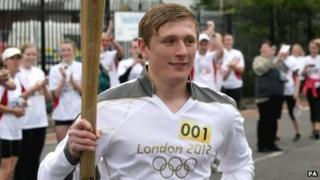 Torchbearer Chris Radburn with the Olympic flame in Middlesbrough