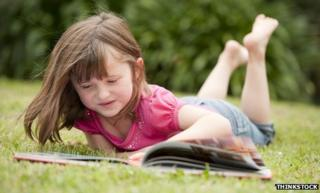 Little girl reading