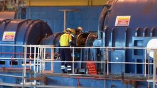 Two men working at a power station