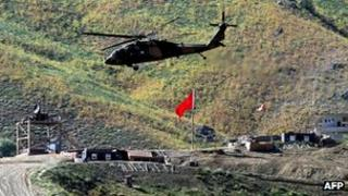 Helicopter flies above Turkish army outpost in Hakkari province on 19 June 2012