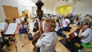 Children from the Big Noise Orchestra rehearse for The Big Concert