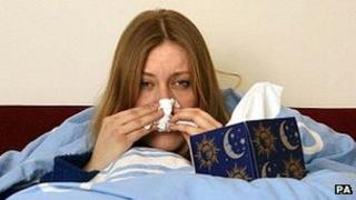 Sick girl in bed - file pic