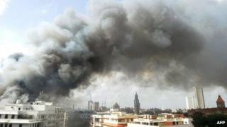 Smoke from the burning Mantralaya building, which houses the Maharashtra state secretariat, is pictured moving past the Mumbai skyline on June 21, 2012.