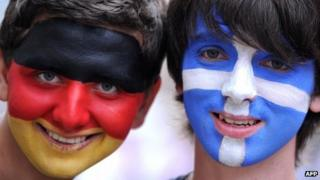 A German and a Greek fan pose in Gdansk on June 22, 2012 prior to the quarter-final match between Greece and Germany during the Euro 2012 football championships