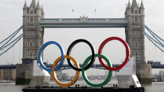 The Olympic rings are pulled down the River Thames (file pic)
