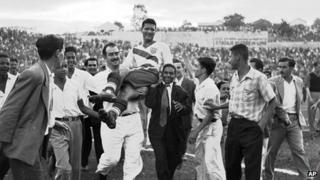 US goalscorer Joe Gaetjens is carried off by cheering fans after his team beat England 1-0 in a World Cup match in Belo Horizonte