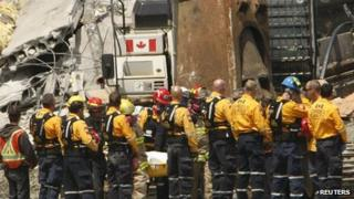 Rescuers carry a body out of the Algo Centre sopping mall, Elliot Lake, Ontario, 27 June 2012