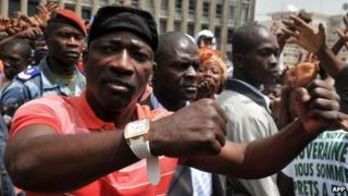 Charles Ble Goude greets the crowd on 5 February 2011 in Abidjan