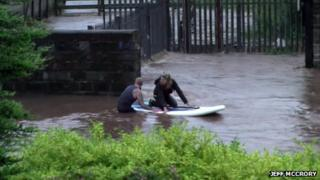 Surfer rescues woman