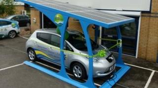 The Nissan Leaf charging in the car port
