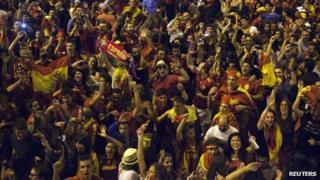 Spanish soccer fans in Madrid celebrate Spain's victory over Italy in Euro 2012 final.