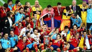 Spain team celebrate on pitch