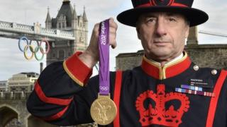 A Yeoman Warder at the Tower of London with an Olympic medal