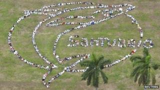 People gather to form a giant human whale with the message Santuario (Sanctuary) in Panama City