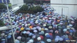 Residents at a municipal government building in Shifang city, Sichuan province