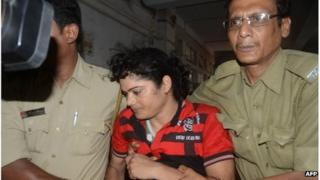 Police escort Former Indian athlete Pinki Pramanik to the Barasat District court in Barasat on 15 June 2012