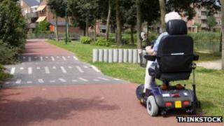 Elderly woman on a mobility scoote