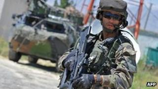A French soldier from the Isaf stands alert in Mahmud Raqi, Kapisa Province on July 4