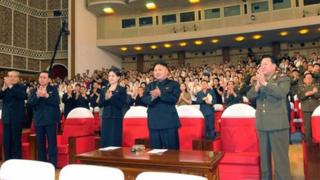 """North Korean leader Kim Jong-Un (C) applauds during a demonstration performance by the newly formed Moranbong band in Pyongyang in this undated picture released by the North""""s KCNA July 9, 2012"""