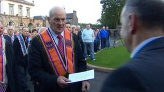 Orangemen handed a letter of protest over Crumlin to a representative of Owen Paterson