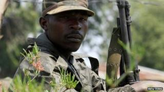 A M23 rebel fighter guards the venue of a news conference by the political leader Jean-Marie Runiga Rugerero in Bunagana, DR Congo